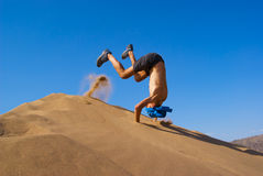 Fun jumping on dune Royalty Free Stock Image