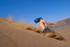 Fun jumping on dune Royalty Free Stock Images