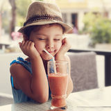 Fun kid girl in hat screwing up her eyes and waiting the moment Royalty Free Stock Photography