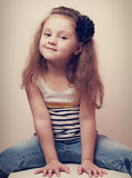 Fun kid small model posing in blue jeans. Vintage portrait Royalty Free Stock Images