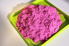 Fun kinetic sand. Purple kinetic sand for indoor children creativity games royalty free stock photo