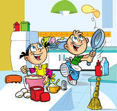 Fun kitchen. In the kitchen  cartoon boy and girl are fried pancakes Stock Photos