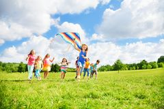 Fun with kite for many kids royalty free stock photo