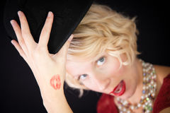 Fun lady with kiss trace on the hand Royalty Free Stock Images