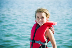 Fun at the lake girl with lifejacket stock image