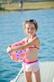 Fun at the lake young girl Stock Photos