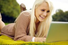 Fun with laptop in park Royalty Free Stock Images
