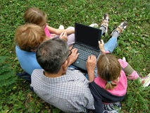 Fun with a laptop in picnic stock photo
