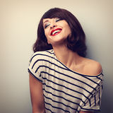 Fun laughing young woman with short hairstyle and closed eyes.  Stock Images