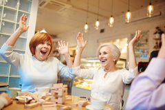 Fun at leisure. Old buddies having fun in cafeteria at leisure royalty free stock photo