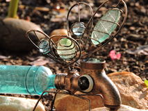 Fun light display..dragonfly yard decoration. Blue and copper yard decoration Stock Photo