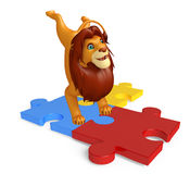 Fun Lion cartoon character with puzzle Royalty Free Stock Images