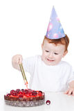Fun little boy with birthday cake over white Royalty Free Stock Photography
