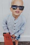 Fun little boy in trendy sunglasses Stock Photos