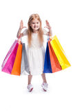 Fun Little Girl with Big Colourful Shopping Bags. Stock Photo