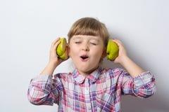 Fun little girl listens to music Stock Photo