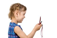 Fun little girl read SMS. Isolate on white Stock Image