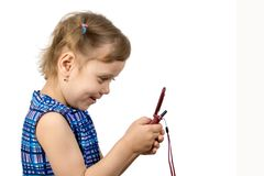 Fun little girl read SMS. Fun little girl playing on a mobile phone, isolate on white Stock Images