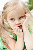 Fun little girl relaxing on a meadow Stock Photography