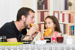 Fun loving dad having breakfast with small Royalty Free Stock Images