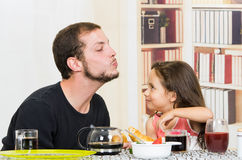 Fun loving dad having breakfast with small Stock Photography