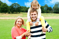 Fun loving family enjoying spring day outdoors Stock Photo