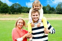 Fun loving family enjoying spring day outdoors Stock Photo