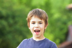 Fun loving little boy child with excited expression Stock Images