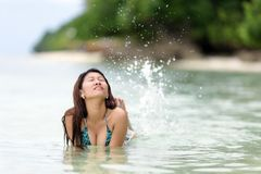 Fun loving young woman splashing Royalty Free Stock Image