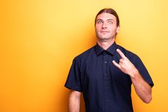 Fun male person showing rock sign. Looking confident Stock Photography