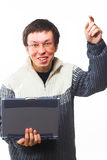 Fun man with laptop Stock Photo