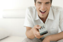 Fun Man with Remote Control Royalty Free Stock Photos