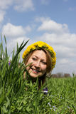 Fun in a meadow. Young woman with flower wreath has fun in a meadow Royalty Free Stock Photo