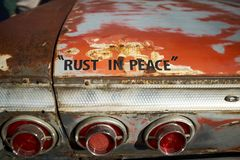 Fun message on an old rusty car - Rust In Peace royalty free stock images