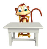 Fun Monkey cartoon character with table and chair Royalty Free Stock Images
