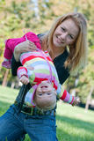 Fun with mum. Mum and her daughter are having fun in the park royalty free stock photography