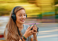 Fun with music headphones Stock Images