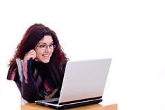 Fun on the net. Beautiful redhead with laptop over white background Royalty Free Stock Photography