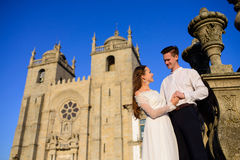Fun newly married couple embrace near the Church Royalty Free Stock Images