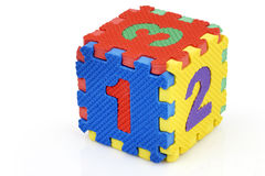 Fun number cube. Fun colorful toy puzzle cube or dice in textured foam for kids to learn their numbers, here 1,2,3 Royalty Free Stock Photo