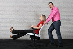 Fun at the office. Two workers having fun at work Royalty Free Stock Photography