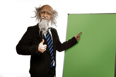 Fun old teacher near blackboard isolated on white Royalty Free Stock Photo
