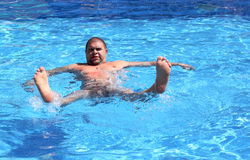 Fun overweight man in pool Royalty Free Stock Photo