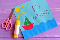 Fun paper holiday card. Children creativity lesson. Paper card with ship, sun, sea. I love summer. Kids summer camp idea for crafts and activity. Inspiration for Royalty Free Stock Photos