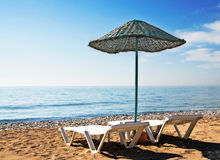Fun parasol and beach in resort. Royalty Free Stock Images