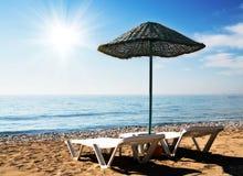 Fun parasol and fun sun on the beach in resort. Royalty Free Stock Photo