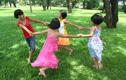 Fun in the park 1 (blur). Four girls playing in the park Stock Photography