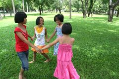 Fun in the park!. Four girls playing in the park Stock Photography