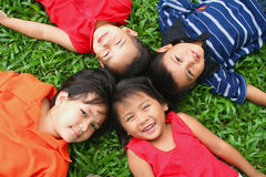 Fun in the park!. Four children having good time in the park Royalty Free Stock Image