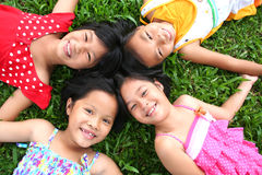 Fun in the park!. Four children having good time in the park Royalty Free Stock Photo